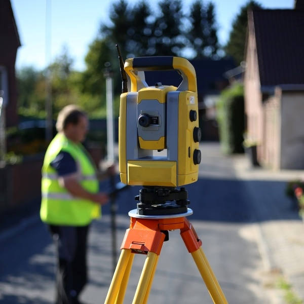 Shows land surveying service being performed