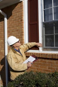Home inspector performing inspection